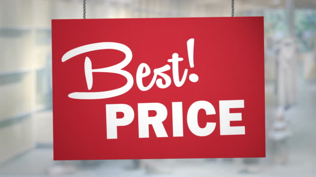 cardboard best price sign hanging from ropes. luma matte included so you can put your own background. - lowering stock videos & royalty-free footage
