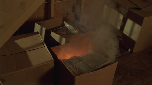 WS Cardboard box full of papers catching fire