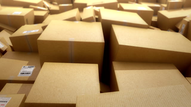 cardboard boxes background. hd loop - package stock videos and b-roll footage