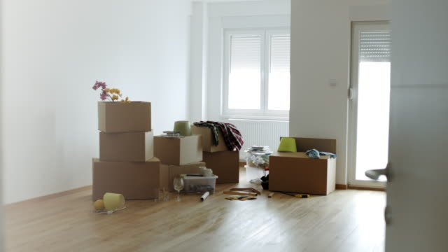 cardboard boxes for moving into a new home - domestic room stock videos & royalty-free footage