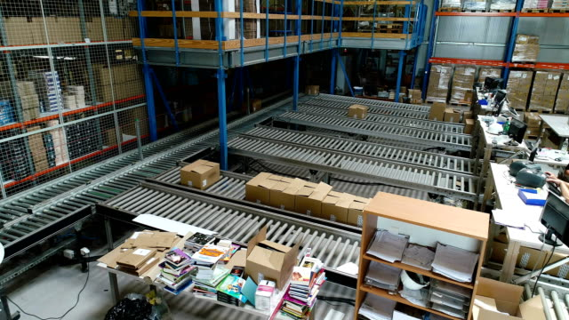 Cardboard boxes moving on a conveyor belt. Aerial view