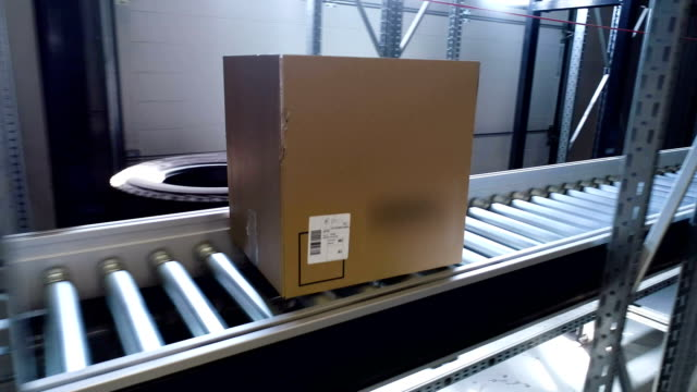cardboard boxes moving on a conveyor belt. close up - following stock videos & royalty-free footage