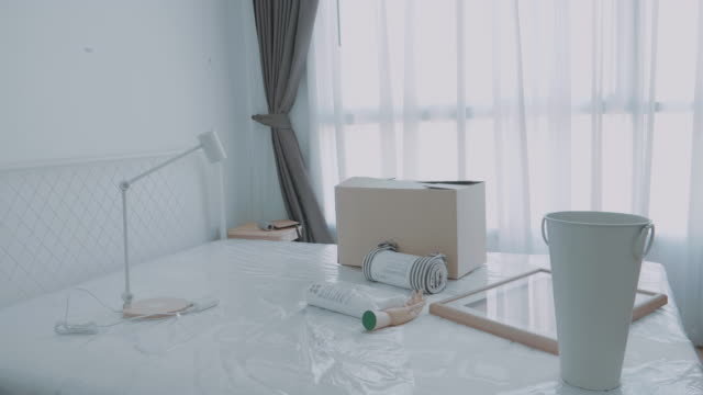 cardboard boxes on bed for moving into a new home - carton stock videos & royalty-free footage