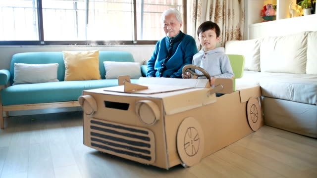 cardboard car - carton stock videos & royalty-free footage