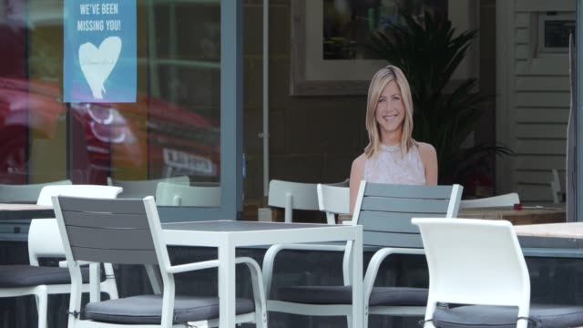 cardboard cut of jennifer aniston at a restaurant to help with social distancing on july 04, 2020 in london, england. the uk government announced... - moving image stock videos & royalty-free footage