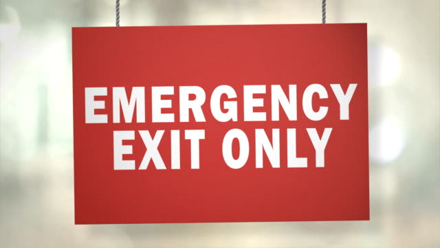 cardboard emergency exit only sign hanging from ropes. luma matte included so you can put your own background. - exit sign stock videos & royalty-free footage