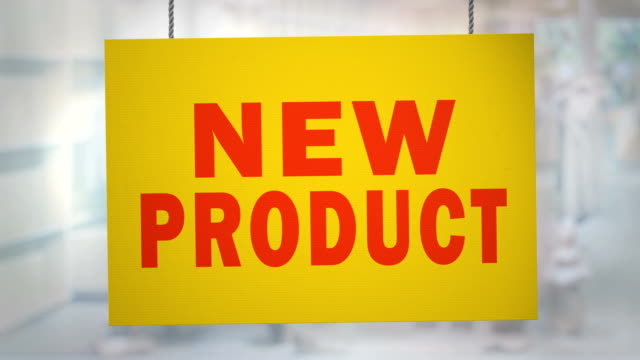 Cardboard new product sign hanging from ropes. Luma matte included so you can put your own background.