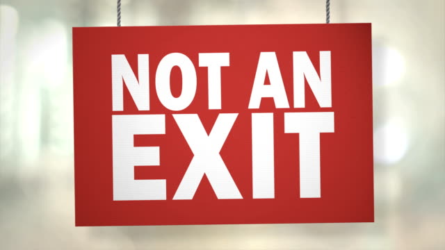 cardboard not an exit sign hanging from ropes. luma matte included so you can put your own background. - exit sign stock videos & royalty-free footage