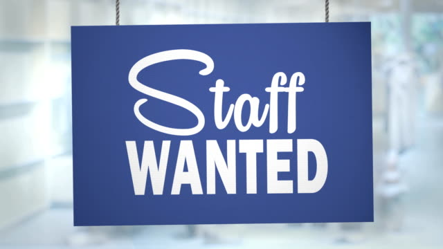 cardboard staff wanted sign hanging from ropes. luma matte included so you can put your own background. - store sign stock videos & royalty-free footage