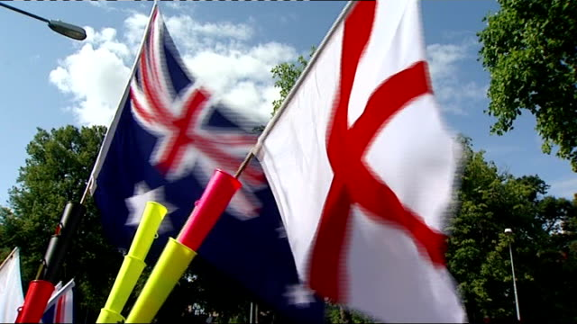 Cardiff EXT Australia and England flags flying England cricket fans wearing masks depicting faces of England cricket team England cricket team fans...