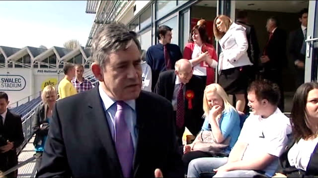 gordon brown mp along followed by peter hain mp , julie morgan , carwyn jones , brown shaking hands with and kissing cheering labour party supporters... - running shorts stock videos & royalty-free footage