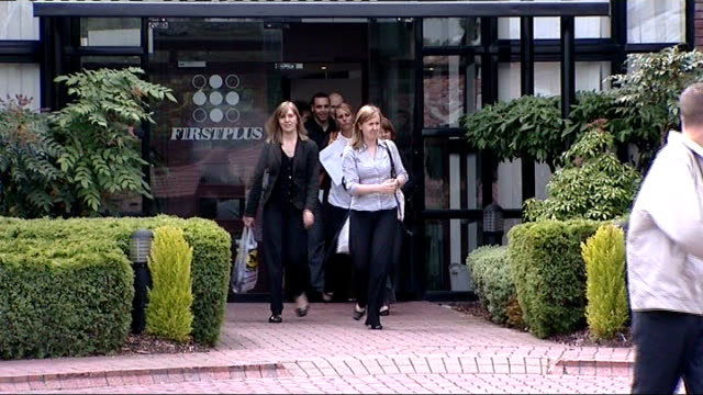vídeos de stock e filmes b-roll de cardiff ext workers leaving premises of company 'firstplus' name 'firstplus house' over entrance back view workers away along street steve pantak... - street name sign