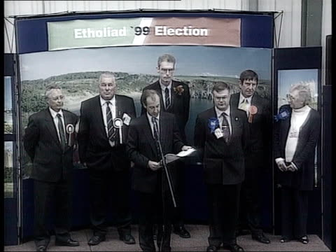 cardiff: ???: int plaid cymru members in room celebrating winning seat in welsh assembly ext welsh secretary alun michael mp posing with wife and... - top of the pops stock videos & royalty-free footage