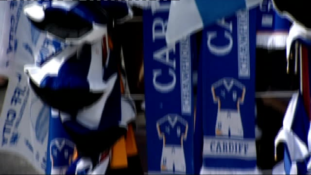 Cardiff Woman selling Cardiff City FC flags Cardiff City flags Vox pops PHOTOGRAPHY ** Dave Jones press conference SOT