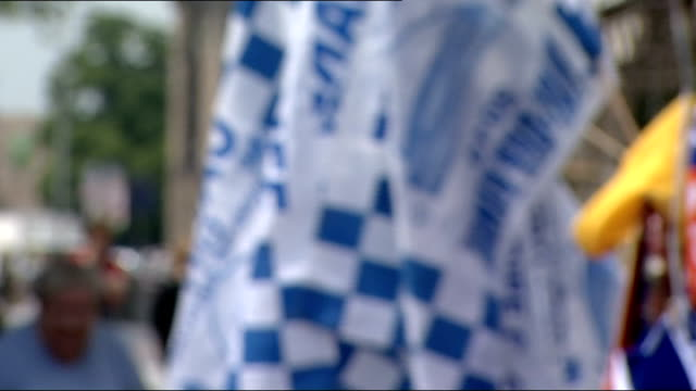 Cardiff Woman selling Cardiff City FC flags Cardiff City flags Vox pops Dave Jones interview SOT