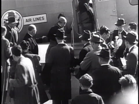 cardinal eugenio pacelli walking next to 'united air lines' boeing 247 commercial aircraft w/ open door followed by his entourage press gathered fg - boeing stock videos & royalty-free footage