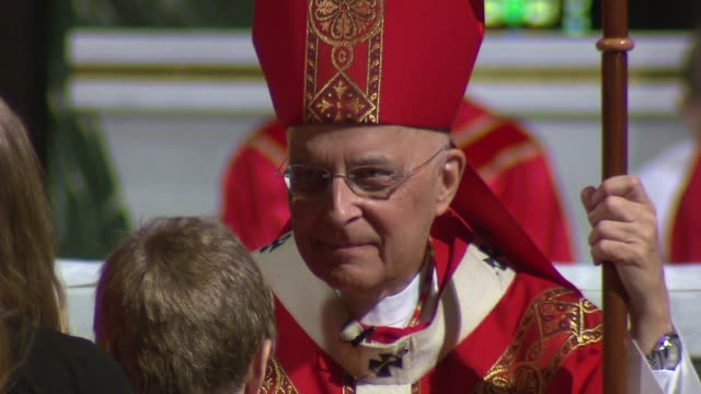 cardinal francis george at st clement church on march 09 2014 in chicago illinois - cardinal clergy stock videos and b-roll footage