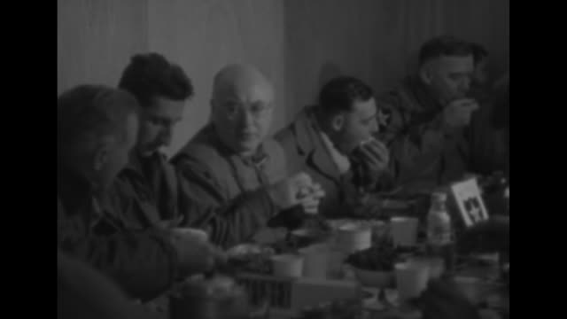 stockvideo's en b-roll-footage met cardinal francis spellman sitting at table in mess hall eating and talking to soldiers general james van fleet commanding general of us eighth army... - south korean army