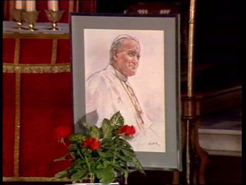 cardinal hume leads mass for pope john paul in london; nat: reporter sam hall england: london: westminster cathedral bv congregation pray as... - pope john paul ii stock videos & royalty-free footage