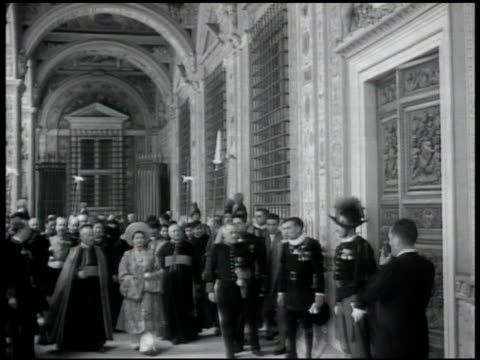 vatican cardinal maglione walking w/ empress anam dignitaries others escorted in hallway by swiss guards cardinal secretary of state the roman curia... - state of the vatican city stock videos & royalty-free footage
