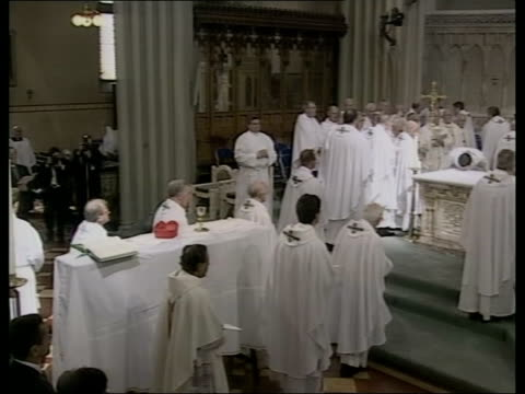 cardinal winning funeral; itn scotland: glasgow ext clergy arriving at st andrews cathedral for the funeral of cardinal thomas winning clergy with... - priest stock videos & royalty-free footage