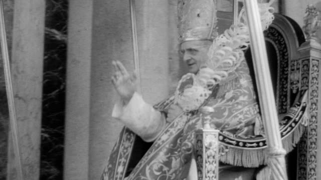 cardinals walk with pope paul vi out of st paul's cathedral to waiting crowd / crowds clapping and cheering by the thousands / pope moves along... - holy week stock videos & royalty-free footage