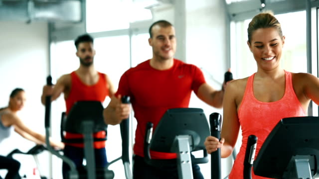 cardio workout in a gym. - exercise machine stock videos & royalty-free footage