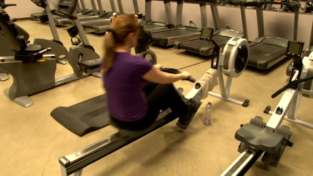 Cardio Workout - Woman On A Rowing Machine