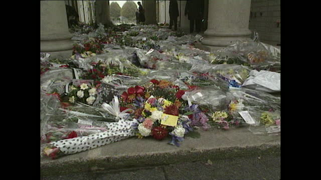 cards and wreaths at entrance of church during the funeral of freddie mercury in west london on the 27th november 1991. shots include a handwritten... - decoration stock videos & royalty-free footage