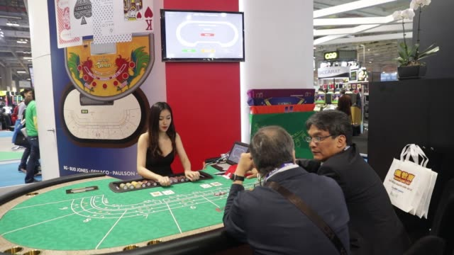 cards are dealt on a baccarat table at the global gaming expo inside the venetian macau resort and casino, operated by sands china ltd., a unit of... - macao stock videos & royalty-free footage