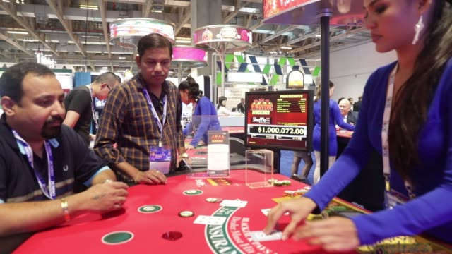 cards are dealt on a blackjack table at the global gaming expo inside the venetian macau resort and casino, operated by sands china ltd., a unit of... - macao stock videos & royalty-free footage