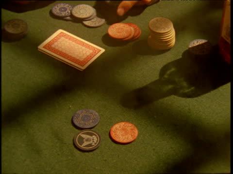 vidéos et rushes de cards dealt chips placed on table in poker game - poker