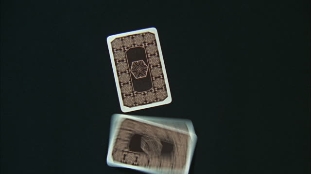 stockvideo's en b-roll-footage met 1966 cu zi cards falling on table face down - vijf dingen