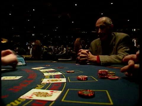 cards taken from shoe la lms men playing craps game with die la cms die collected by croupier cms hand pushing buttons on slot machine cms man sat at... - card table stock videos & royalty-free footage