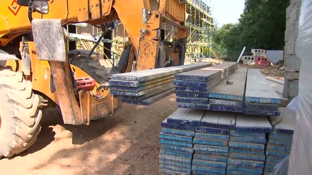 care home construction site gvs; england: oxfordshire: ext various of mechanical truck moving planks on care home construction site - oxfordshire stock videos & royalty-free footage
