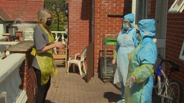 care home staff wearing full ppe at st ives lodge in essex - england stock videos & royalty-free footage