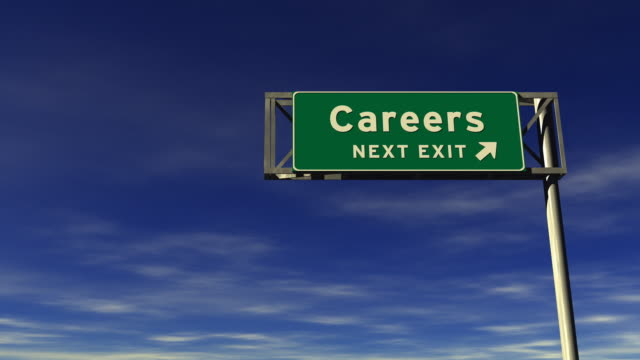 careers freeway exit sign - exit sign stock videos & royalty-free footage