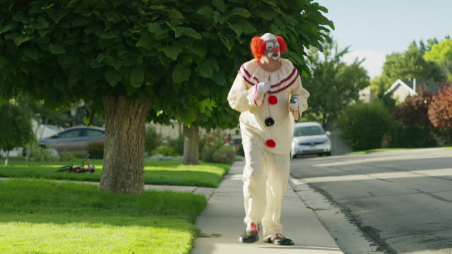 carefree clown dancing on sidewalk listening to music / cedar hills, utah, united states - clown stock videos & royalty-free footage