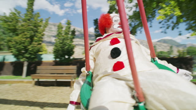 carefree clown laying and swinging on tire swing / pleasant grove, utah, united states - tyre swing stock videos & royalty-free footage