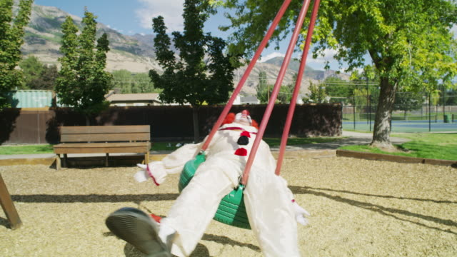 carefree clown laying and swinging on tire swing / pleasant grove, utah, united states - tire swing stock videos & royalty-free footage