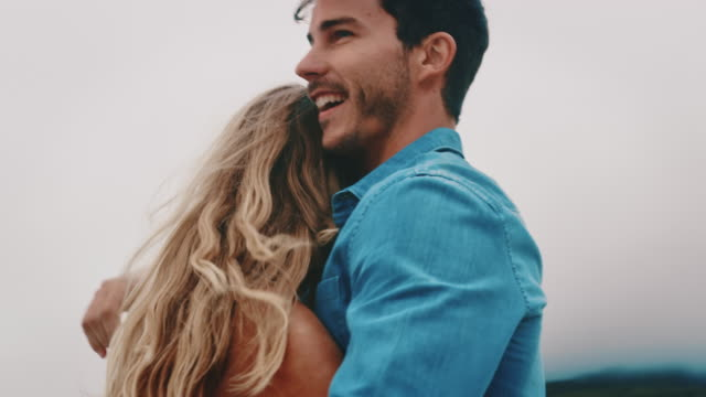 vídeos de stock e filmes b-roll de carefree couple dancing at beach during weekend - amor