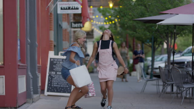 carefree girls carrying shopping bags dancing on city sidewalk / provo, utah, united states - sandal stock videos and b-roll footage