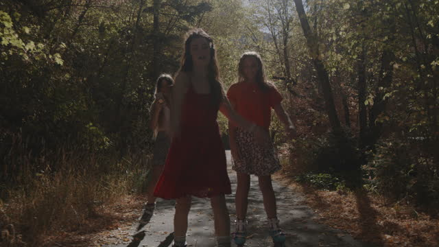 carefree girls inline skating and listening to headphones on park path in autumn / american fork canyon, utah, united states - american fork canyon stock videos & royalty-free footage