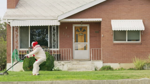 carefree silly clown mowing grass at house / pleasant grove, utah, united states - clown stock videos & royalty-free footage