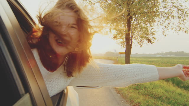 carefree teenage girl riding in car with head out window, real time - only teenage girls stock videos and b-roll footage