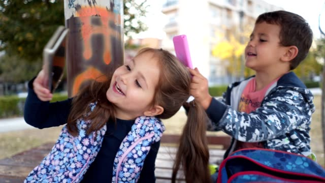 carefree three year olds playing on their toy smartphone device - 4 5 anni video stock e b–roll