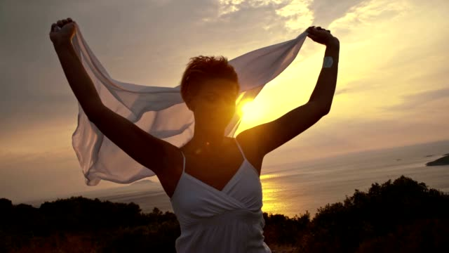 slo mo carefree woman running with shawl in the wind - scarf stock videos & royalty-free footage