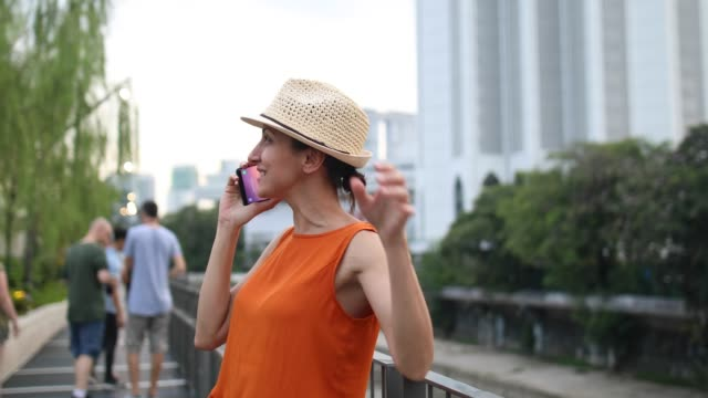 carefree woman talking on phone - malaysia stock videos & royalty-free footage