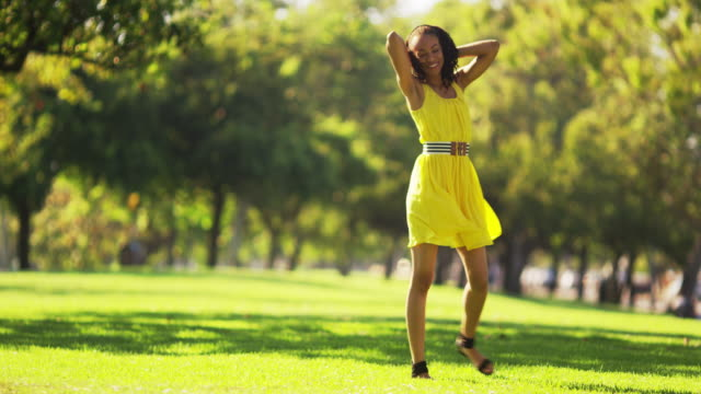 Carefree woman walking on the grass