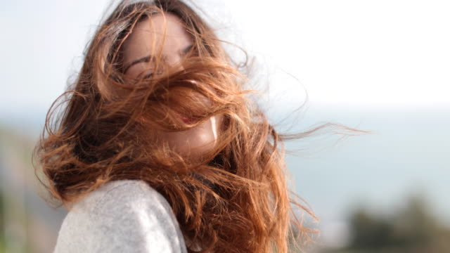 Carefree woman with wind in her hair